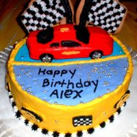 Racecar Cake My son really enjoyed his birthday cake. He loved the gold dragees & wanted the whole thing covered in them. This was fun to do...
