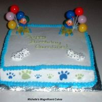 Puppy And Clown Cake This is a chocolate cake with BC icing. The clowns and puppiies are made of RI (store bought clown heads and balloons). BC puppy feet along...
