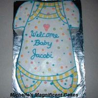 Onesie Cake This cake is a copy of the invitation for a baby shower. Half-sheet cake carved to the shape and decorated.