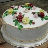 Old Country Roses   White cake with strawberry cream filling. Fondant covered with gum paste roses.
