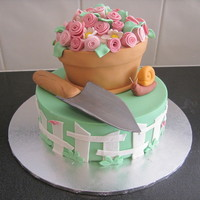 "Garden Party An 8"" mud cake covered in fondant and 6"" carved flower pot. I made this for my friends garden party."
