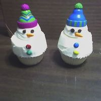 Snowman Cupcakes The top of the cupcake is all buttercream but you could probably use a marshmallow for the head. The hat is plastic, mini chocolate chip...