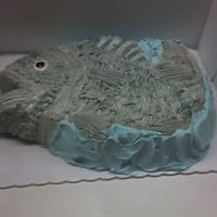 Buttercream Fish Groom's cake. This was done with buttercream tinted grey and brushed with blue and green luster dust. Oversprayed with a silver food...