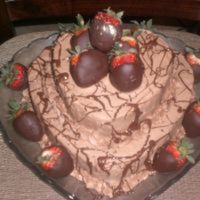 Valentine Cake Heart shaped chocolate fudge cake with fluffy chocolate buttercream frosting. Decorated with chocolate covered strawberries and drizzled...