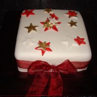 Coloured Stars fruit cake covered with fondant