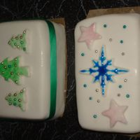 Two Christmas Cakes fruit cake covered with fondant.