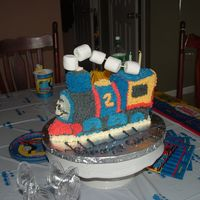 Thomas The Train Cake   my son is addicted to trains. Used train pan and did my own thomas impersonation. Marshmallows for smoke stack