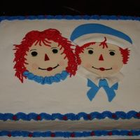 Raggedy Ann And Andy This is a chocolate cake iced in buttercream. I hand painted the faces on fondant . I accented with MMF and buttercream.