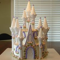 Castle Birthday Cake This is my version of the wilton caslte cake. I had alot of fun doing this cake. There is a very happy 5 year old little girl!