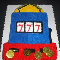 Slot Machine This cake was for a granny who loves to play the slots. buttercream with some fondant accents and edible chocolate coins.