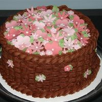 Chocolate Basket Weave This is a chocolate cake with chocolate filling that I added international coffee and cinnamon to . I used fondant flower cutouts for the...
