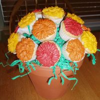 Fall Mini Cupcake Bouquet My first successfully cupcake bouquet!! I have better success with the mini cupcakes. Thanks to Cambo for the inspiration for the mum...