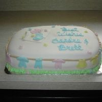 "Baby Clothes  My first ""paid"" fondant cake-designed to go with shower invites. I think I could enjoy these kinds of cakes if I did them more..."