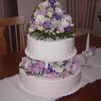 2Nd Wedding Cake  This was a rum cake, one layer of chocolate filling, the other vanilla, with butter cream frosting-small backyard wedding-cake modeled...