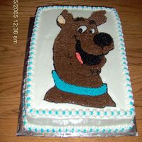 Scooby Doo   One of two character cakes (birthday for twins) traced by hand on top then done with stars. The other is Ariel, The Little Mermaid.