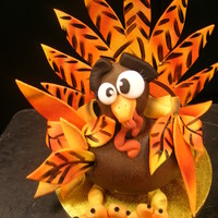 Big Turkey Body of turkey was cake.Legs,feathers,head and back feathers were fondant and gumpaste.TFL!