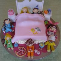 Sleepover  Got the idea from other cakes on this site. Coconut cake covered in buttercream with fondant figures and blanket. Piped buttercream ruffle...