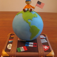 World Traveler  Ganache covered suitcase cake with fondant accents. Globe is actually a hollow styrofoam ball (as we didn't need more cake) filled...