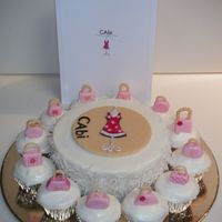 Cabi Party Cake   Coconut cake and cupcakes covered in cream cheese frosting and coconut. Fondant purses and logo.