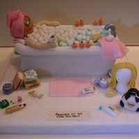 Fabulous At 40 - With Some Help  I was inspired by many of the other bathtub cakes posted by CC members. My version incorporates many inside jokes relevant to the birthday...