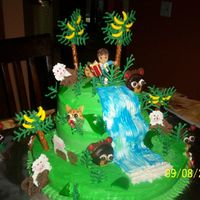 Go Diego Go, Rain Forest, Diego Rain forest Cake for my sons 4th birthday. He loves Diego. Everything is edible except for the Diego candle.