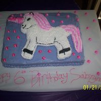 Unicorn Birthday Cake For My 6 Yr Old Daughter I made this from the rocking horse cake pan for my daughters 6th birthday. The fairy tall unicorn horn was made out of rice crispy treats,...