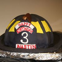 Firefighter Helmet Cake Thanks A TON to thecakemaker!! I baked a 10'' cake and used the soccer ball cake pan (the one that is just half of it by Wilton)...