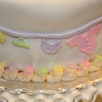 Close Up Of Layette On 'em This picture goes with the next one. It just shows the detail of the cake.