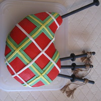 Bagpipes I made this for my dad's birthday which was just after he returned from Scotland. Iced in buttercream with fondant accents. I did my...