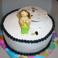 You Can't Stop Time! The cake is chocolate with strawberry filling. The woman is made of fondant, as it the face of the clock. The clock actually works! This is...
