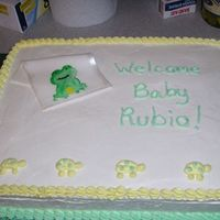 "Tiddliwink Frog Baby Shower Cake White cake with bc frosting. Fondant ""blankey"" with tiddliwink frog painted on. When I tried to put ribbon around the cake, I..."