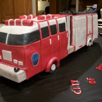 Firetruck Cake Big firetruck cake. It was a little over 2 1/2 feet long!If I had more time, I could have added more details...