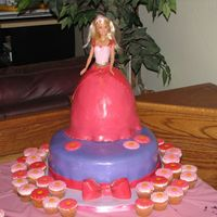 Barbie Cake With Flower Cupcakes Barbie cake for a 4th birthday party. Matching mini cupcakes with white chocolate flowers on top. Fondant covered Pampered Chef Batter bowl...