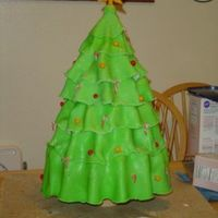 6 Tier Christmas Tree Cake  This was a 6 tiered cake - each tier supported by a star shaped acrylic plastic sheet (custom cut). Each tier was cut to match the shape of...