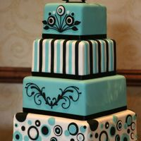 Tiffany Blue And Black The design of this wedding cake was based on the graphics used on the couple's wedding invitations.