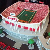 "Arrowhead Football Stadium In Kansas City 12"" square cake is under the stands. Walkways and stands are pastillage, as well as signs and scoreboard. Everything else is a mixture..."