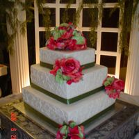 Square 3 Tier Wedding Cake Square (13, 10, 7 inch) 3 tier wedding cake. Silk hydrangea/roses on top and on tiers with ribbon borders... white cake inside with...