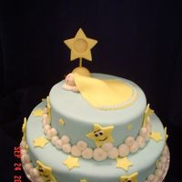 Baby Shower Cake - Boy French vanilla cakes covered in buttercream then covered with light blue MMF .. MMF stars were cut out and some where decorated with eyes,...