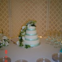 4 Tier Round Wedding Cake Just a plain cake really. Four tiers, 12,10, 8 and 6 inches round with ribbon bottom borders. Flowers were silk with calla lilies and...