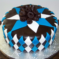 Blue And Brown Birthday Argyle inspired pattern. Chocolate fondant with fondant details. Thanks for looking!