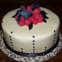 Mocha Raspberry Mocha Cake with Raspberry filling. Mocha fondant and fresh raspberries with royal icing detail.