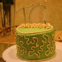 2Nd Cake - Initials  This is buttercream frosted cake using moss green food coloring. No classes for me, I am self taught. Still learning to get better on the...