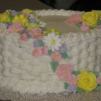Img_20060905_0090.jpg  This was my final cake for course II. I need a lot more practice with the basketweave and rope border, they didn't turn out so great!...