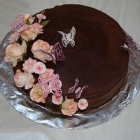 Chocolate Ganache Covered Cake  Chocolate cake with whipped chocolate raspberry ganache. My daughter made the cake for my sister in-laws birthday. Gumpaste sugar flowers...