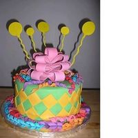 Curly Q's Cake Curly Q's, miniature presents, diamond cutouts, bow and balloons....