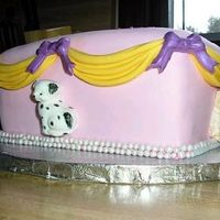 Puppy Cake White cake w/ strawberry filling, covered in Satin Ice. Puppies, Swags and Bows also made from Satin Ice. Pearl boarder completes cake.