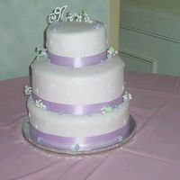 Forget-Me-Not Cake 3 tier cake (8'' top, 12'' middle and 14'' bottom) for 125 guests. Cake is covered in Pink Fondant and...