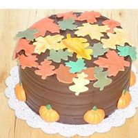 Thanksgiving Cake Choc. cake with Choc. frosting. Satin Ice leaves and acorns on top of cake. Choc. pumpkins on bottom of cake.