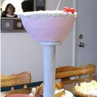 Cosmo Martini  Well Here is my Cosmopolitan Martini... It is achocolate cake with whipped cream icing. Thank You to my husband for transforming the stand...
