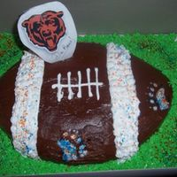 Chicago Bears Cake Chocolate and peanut butter frostings on a dark chocolate fudge cake. I made paw print stencils and sprayed and sprinkled them. For a...